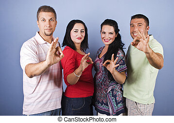 Cheerful group people show okay signs