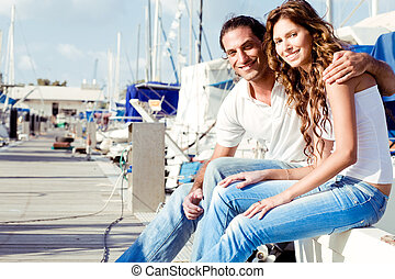 Smiling couple at boat harbour - Smiling couple at boat...