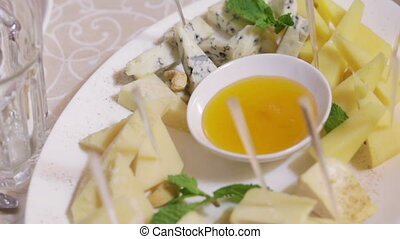Assorted cheese - Set of sliced cheese with walnuts and...