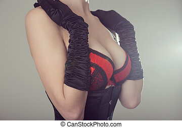 Beautiful woman in black corset and red bra