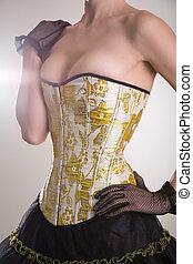 Beautiful burlesque girl in golden corset
