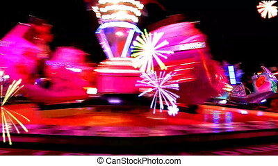 Fairground at night in city