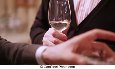 Champagne in hand - In hands man glass of champagne on...