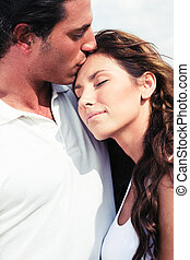 Affectionate man kissing - Young man kissing on forehead