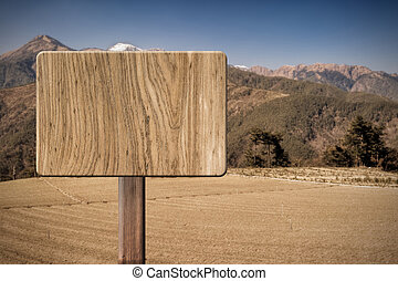 Blank wooden sign on field of farm Concept of rural,...