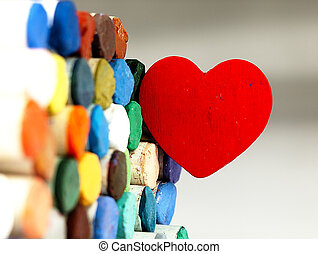 Heart and colored dry pastels closely - Heart on the...