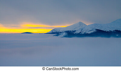 Majestic sunset in the winter mountains landscape. Dramatic...