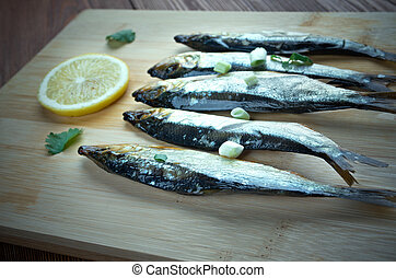 Bloater - type of whole cold-smoked herring.particularly...
