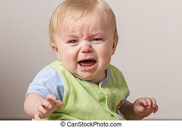 Young chlid upset and crying - Child with arm stretched out...