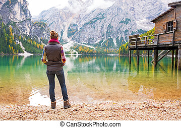 Full length portrait of young woman on lake braies in south...