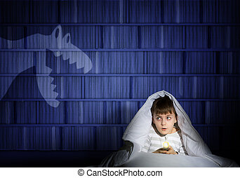 boy under the covers with a flashlight - image of a boy...