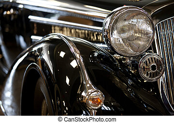 old car - part of a black old car with headlamp