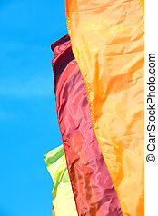 varicolored flags - strong wind and varicolored flags on a...