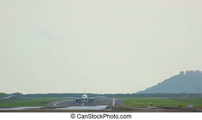 On the runway - Airplane taxiing on the runway,...