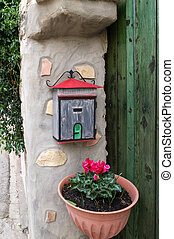 letter box next to a wooden portal