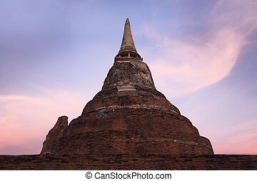 old ruin stupa in thai temple with beautiful sky background