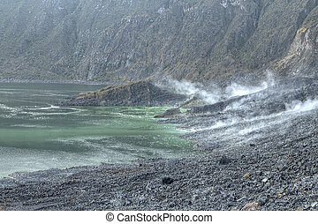 Volcanic activity - Vapors and gases rising from hot...