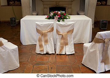 Wedding ceremony table - Rows of chairs at a wedding...