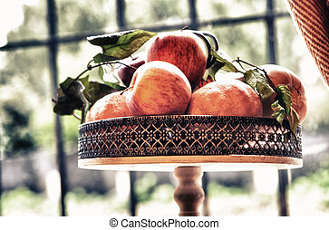 Apples over copper metal tray - Close up of fresh organic...