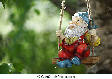 garden dwarf on green nature background