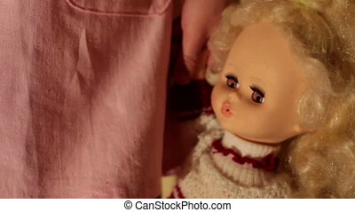 Doll in a girl's hands closeup - Little girl holding the...