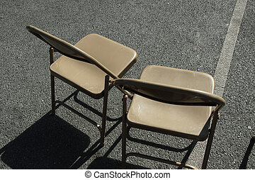 empty chairs before an event