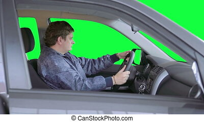 Man drives a car. Green background - The driver to overtake...