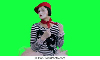 The mime girl cries hysterically - The girl mime against a...