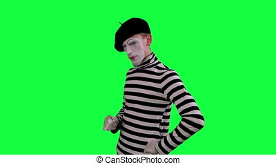 The mime boy suspects something - The boy mime against a...