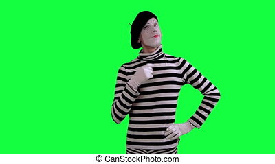 The mime thinks about something - The boy mime against a...