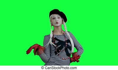 The mime posing like a fashion mode - The girl mime against...