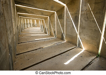 light at the end of the tunnel - a gloomy concrete tunnel,...