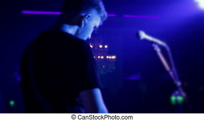 Lead singer performs on stage