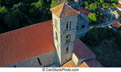 Ston church tower, aerial - Copter aerial circular view of...