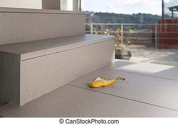 Banana peel on the edge of a stair