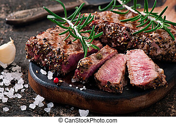 Juicy steak medium rare beef with spices