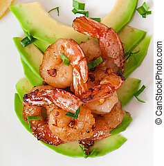 Shrimp sauteed with garlic and soy sauce on a cushion of...
