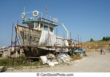 old ship - repair of old ship on the coast of the Black Sea