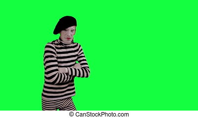 The mime intimidates and threatens - The boy mime against a...