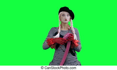 Mime makes figure of the balloon - The girl mime against a...