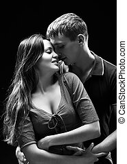 Portrait of a passionate couple - Monochrome studio portrait...