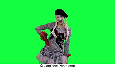 The girl mime funny dancing - The girl mime against a green...