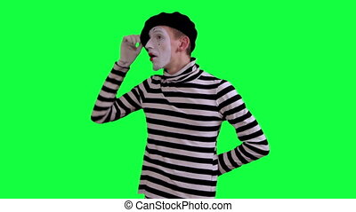 The mime is frightened of something - The boy mime against a...