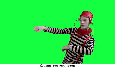 The mime as a driver - The boy mime against a green...