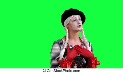 The girl mime flirting funny - The girl mime against a green...