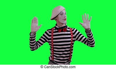 The mime is behind invisible wall - The boy mime against a...