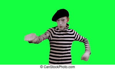 The mime shows thumb down - The boy mime against a green...