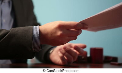 Review of contract and handshake - Businessmen consider...