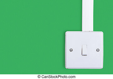 Light switch mounted on white wall