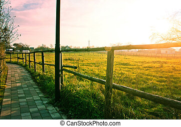 Nature concept - Sidewalk in country scenery with green...